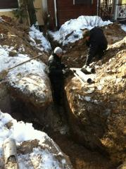 Digging of trenches with laying of the sewerage