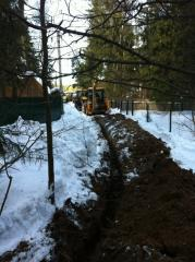 Digging of trenches with laying of water supply