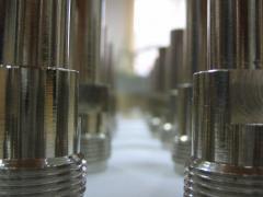 Enrobage par nickel des  pièces d'équipement commercial
