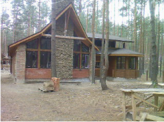 Construction of country wooden houses, on a