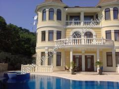 Exterior finish by a stone of facades, houses,