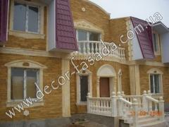 Облицовка фасадов домов природным камнем