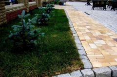 Services in a paving of a brick stone blocks in