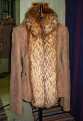 Tailoring, having altered sheepskin coats and fur