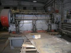 Guillotine cutting of metal rolling