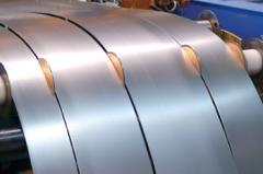 Cutting of sheet metal on the strip