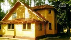 Обшивка деревянного каркасного дома имитацией бруса