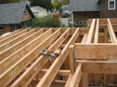 Laying of a board of half of the frame house on