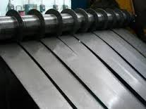 Cutting of rolls on strips