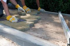 Laying of paving slabs of a stone blocks, stone