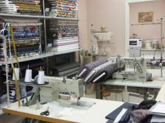 Services of sewing on raw materials supplied by