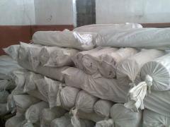 Open fabrics in rolls.