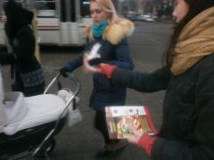 Handing out newspapers on the streets of the city.