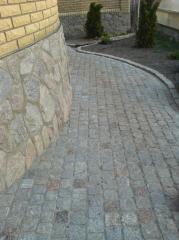 Laying of a granite stone blocks and granite