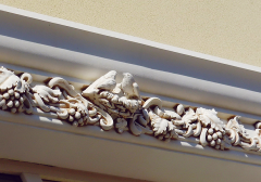 Dressing of a stucco molding and architectural