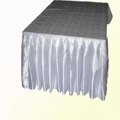 Cloth with a skirt on a table
