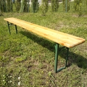 The bench is wooden folding