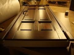 Production of doors from metallayer
