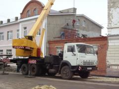 The truck crane on the KAMAZ base, loading
