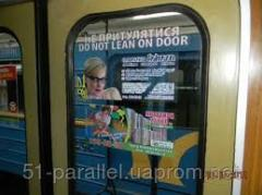 Advertizing on doors of cars of the subway