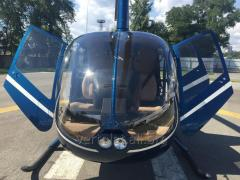 Flight by Robinson R66 helicopter