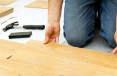 Installation of a laminate, linoleum, parquet,