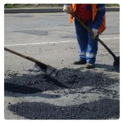 Patching of asphalt concrete coverings Fastov