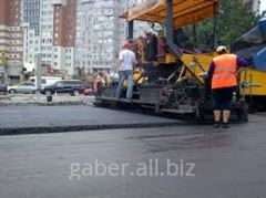 Asphalting of roads, sidewalks, city