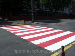 Drawing by paint and plastic of a road marking