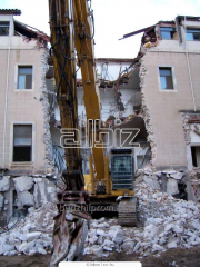 Dismantle of houses, brick and concrete walls,
