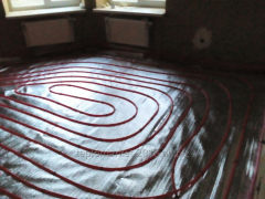 Installation of heat-insulated floors in Sumy.