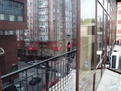 Установка бронирующих (защитных) пленок на стекла зданий -бронирование стекол