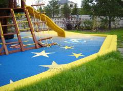 Laying of sports coverings for playgrounds