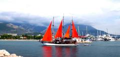 Rent a yacht with red sails
