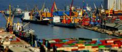 Складирование и перевалка грузов в портах