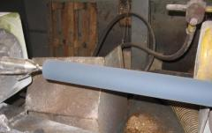 Rubber-coating of metal surfaces