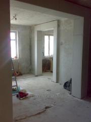 Расширение,резка проемов,стен с усилением металлом.Алмазная резка бетона.Демонтаж,сверление отверстий в Харькове.