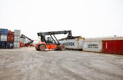 Транспортно-логістичні послуги пов'язані з обробітком та автодоставкою вантажів в лінійних контейнерах