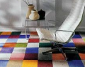 Delivery and installation of a modular carpet tile