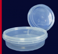 Plastic tight packing for fish preserved food and salads. Non-standard plastic products